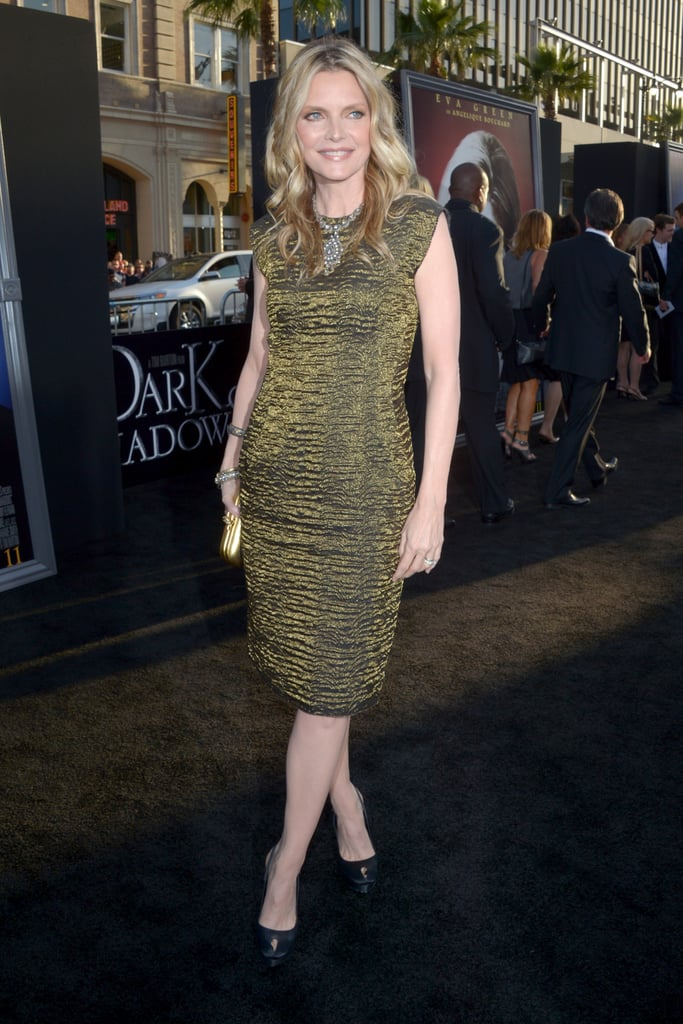 Michelle Pfeiffer showed off her body in a tight-fitting iridescent dress for the Dark Shadows premiere in LA.