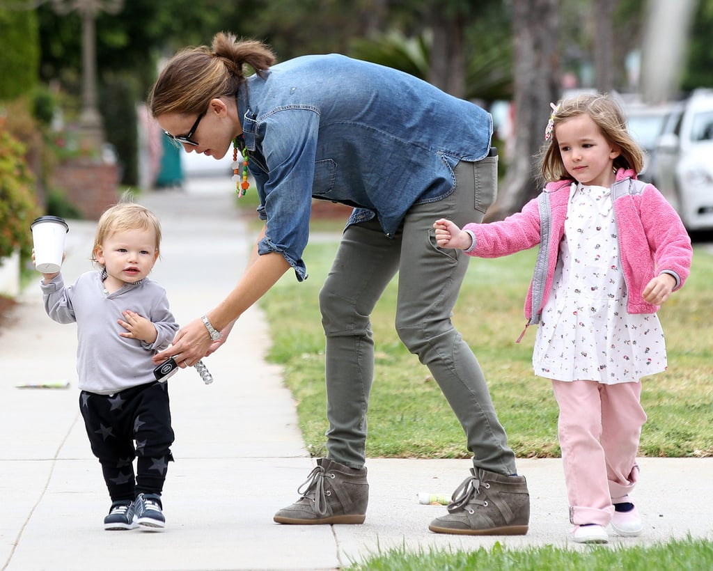 Jennifer Garner took her kids to lunch in Santa Monica, CA, as Samuel showed off his walking skills and Violet pranced around in pink.