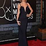 Taylor Swift channeled old Hollywood glam in a plunging navy Hervé Léger gown.