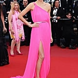 Jessica Hart showcased a bold, bright pink gown and Chopard jewels — and a little leg — at the Behind the Candelabra premiere.