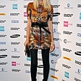 Claudia Schiffer attended the Fashion Fringe fashion show donning a cool printed dress with tights and booties.
