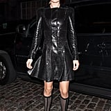 "Doutzen Kroes's black studded Versace coat dress gives new meaning to the term ""babe in black."" The model perfected the dominatrix look at a recent event, pairing her long-sleeved pleated leather piece with knee-high mesh boots."