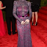 Carolina Herrera dressed Minka Kelly in a sheer lace gown with a bejeweled neckline, while Lorraine Schwartz dripped her in jewels.