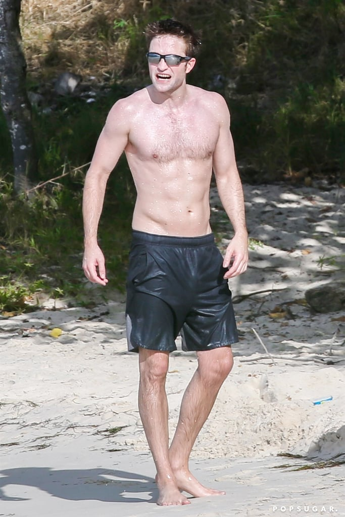 Robert Pattinson went shirtless for a sweaty beach workout in Antigua on Monday. The 31-year-old actor showed off his physique as he ran laps with a trainer, all while lifting a duffel bag full of sand — impressive! We last saw Robert when he took the stage to present an award with his Harry Potter and the Goblet of Fire costar Emma Watson at the Golden Globes in January, but he also appeared to be enjoying his singledom while checking out the NY Knicks dancers during a game in November. Yes, Rob and his fiancée, singer FKA Twigs, called it quits back in Summer 2017 after three years of dating. Rob was reportedly leaning on pal Katy Perry after the split, but it looks like he's doing pretty well these days. Keep reading to see Rob's shirtless beach day.      Related:                                                                                                           Robert Pattinson Might Not Be a Vampire Anymore, but We're Still Thirsty For Him