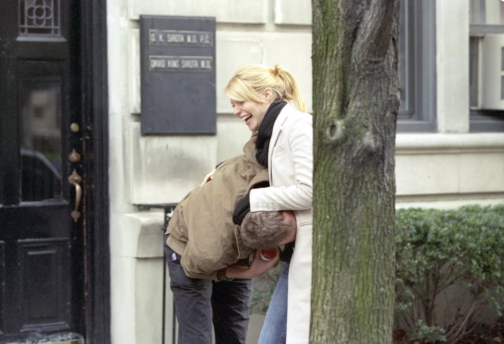 Chris Martin horsed around with a pregnant Gwyneth Paltrow in NYC in December 2003.