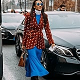 Make a Summer dress Winter appropriate by pairing it with a turtleneck, blazer, and over-the-knee boots.