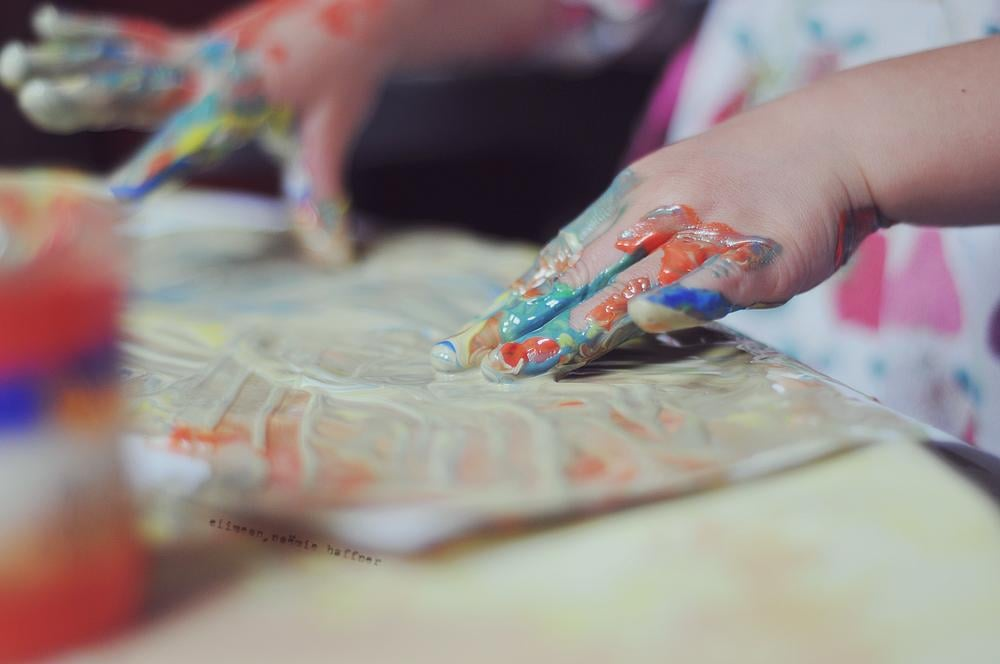 For very little ones, put paint inside a Ziploc bag with a piece of white paper.