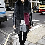 Olivia dared to wear shorts in Winter by pairing the leg-baring style with tall boots and a tweed and leather coat.