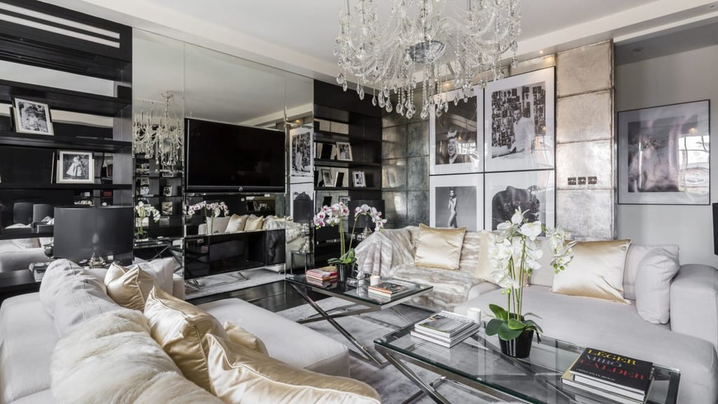 """Alexander McQueen's legacy in the fashion world is anything but simple, and now, fans of his designs have the chance to live in his magnificent penthouse, decorated to honour him with his style. But just like his designs, it won't come cheap! McQueen's two-story London penthouse recently hit the market for $10.6 million. The late designer purchased the Mayfair property in 2009, but after taking his life a year later, the gorgeous duplex penthouse was decorated by Paul Davies London to pay homage to McQueen """"at the request of the current owners who had purchased the property from a McQueen trust,"""" according to Women's Wear Daily. The 166-square-metre apartment includes two spacious bedroom suites and is filled with portraits of the designer himself. With photos straight from his runway shows and his notorious skull motifs, McQueen's legacy is living right in this beautiful property. A spiral staircase leads residents to a 67-square-metre roof terrace with sweeping views of Mayfair and a perfect area for entertaining.  """"It was a two-year labour of love,"""" a spokesperson for Paul Davies London told Women's Wear Daily. """"The current owner bought it as an investment, but later wanted to refurbish it as an homage to Alexander McQueen.""""  Keep reading to see photos of the breathtaking London penthouse.       Related:                                                                                                           Fashion Designer Tom Ford Is Selling a Breathtakingly Beautiful Estate the Size of Manhattan"""