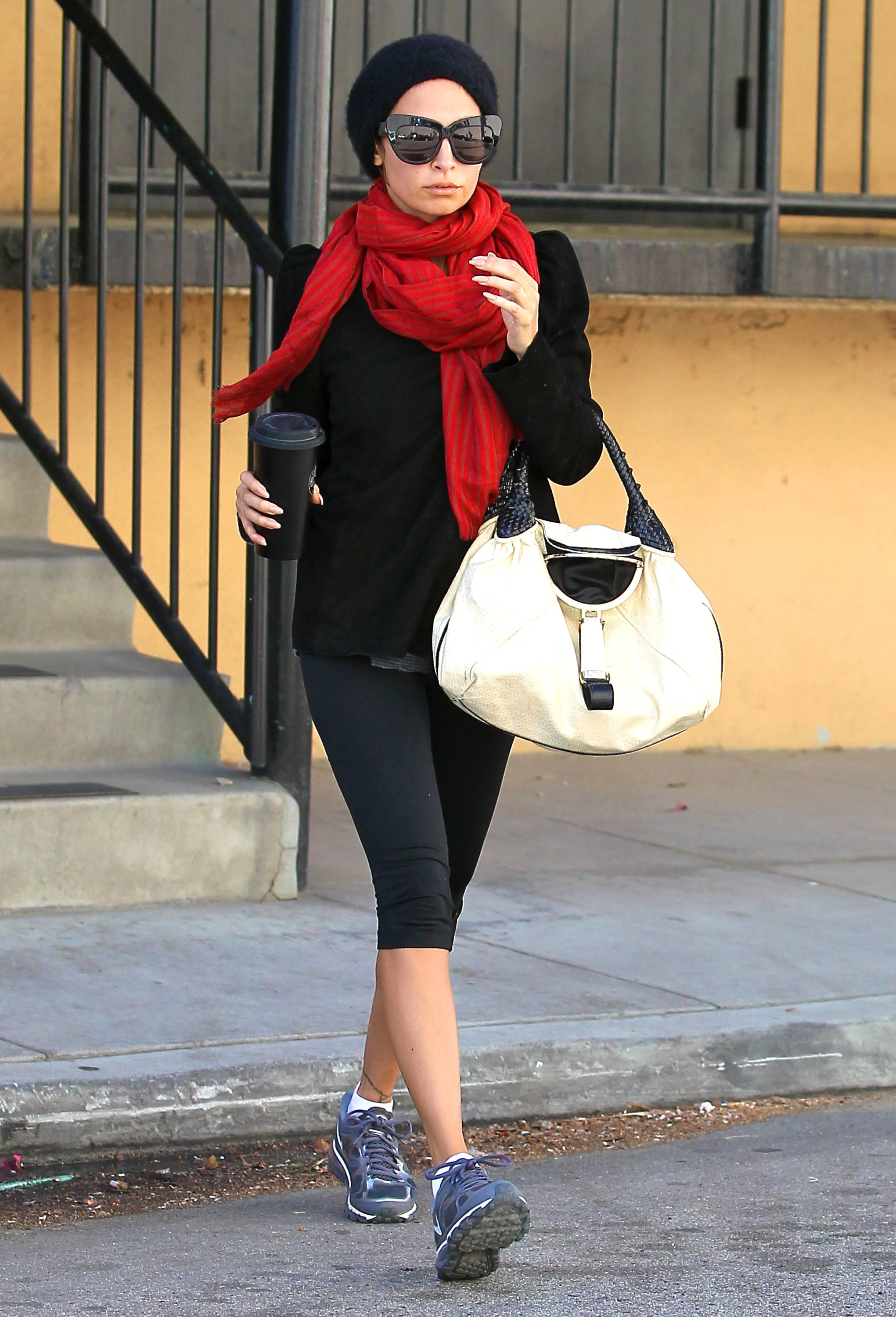 Nicole Richie wore a red scarf and black beanie in LA.