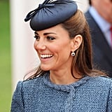 A sweet, bow-adorned  Rachel Trevor-Morgan hat to match her tweed jacket during a visit to Vernon Park in 2012.