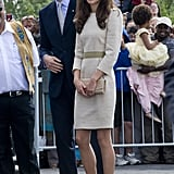 Kate wore a flattering Malene Birger sheath that featured a contrast stripe across the center. She kept her accessories minimal and neutral, selecting L.K. Bennett pumps and Kiki McDonough earrings.