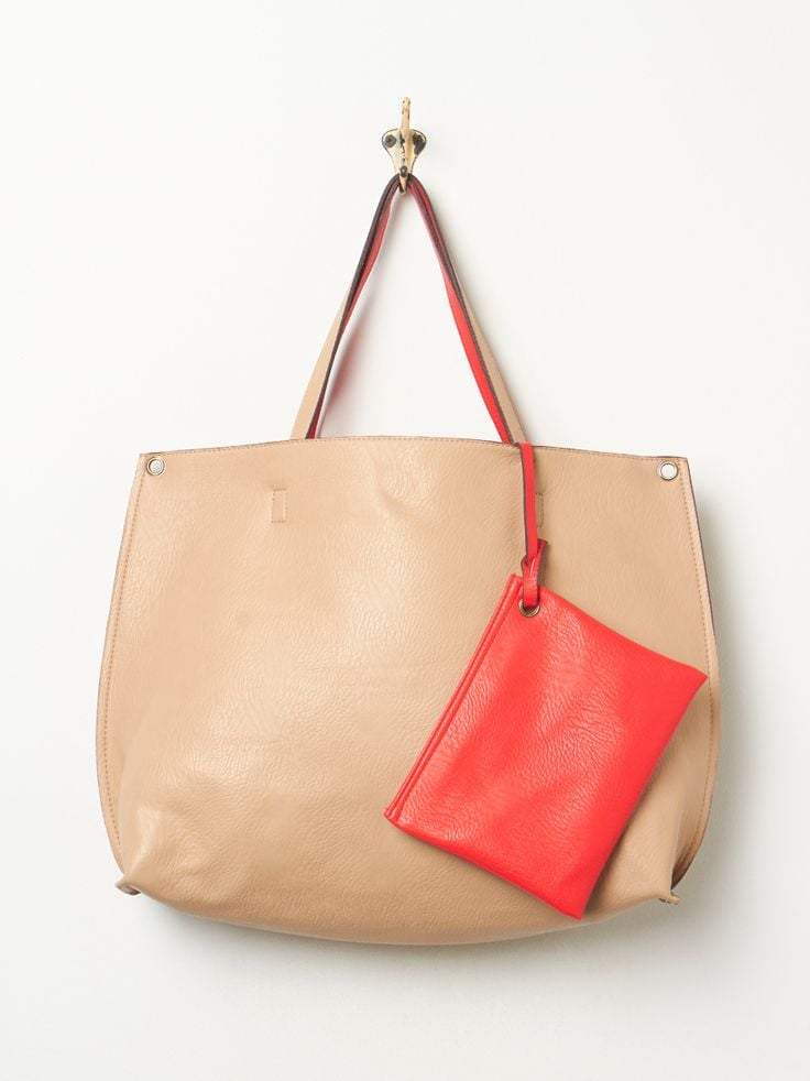Not only is this slouchy vegan tote ($68) one of the prettiest bags out there, but it features a large removable zipper pouch to keep her laptop or tablet. Plus, it comes in different colors for every mom's taste!