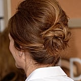 "Julia's ""modern twist on a '60s updo"": get the skinny on her luscious locks here."