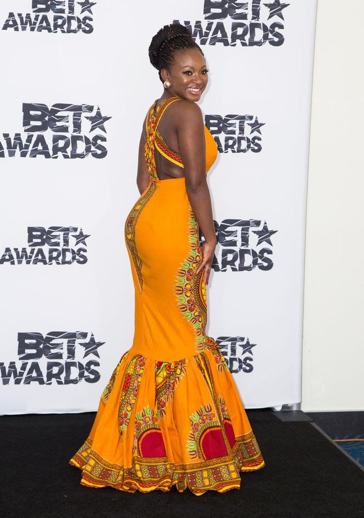 Singer Naturi Naughton spun around and revealed the strappy back detail of Kyemah McEntyre's dress!