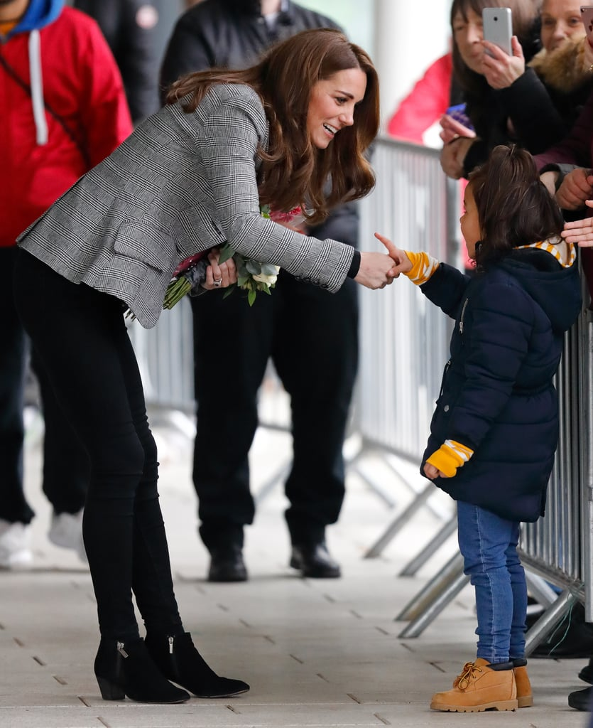 She shook hands with a young girl at an event in London in October 2018.