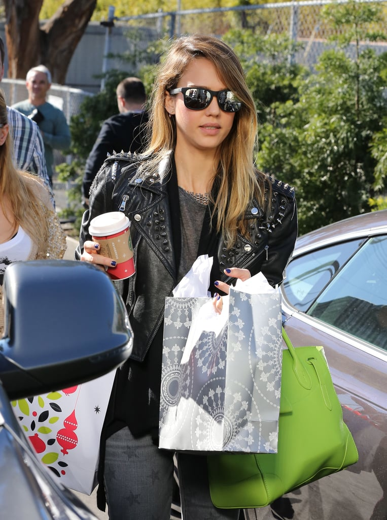 "Jessica Alba squeezed in some Christmas shopping yesterday during a trip to Target in Westwood, CA. Jessica, who wore a leather jacket by Simone, made her way through the store's parking lot with a cart stuffed full of items. The actress's retail trip was just another example of her recent bout of festive cheer. Yesterday, Jessica tweeted out a snap of friend Mindy Kaling's Christmas card, declaring it ""the best ever,"" and last night she treated her Honest Company staff to an end-of-the-year dinner. She also made sure that her daughters have been enjoying their holiday time by taking the family to Disneyland earlier this week."