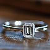 A sleek, classic emerald-cut ring like this Nora Kogan Sarah ring ($3,475) belongs on the finger of a sophisticated styler.