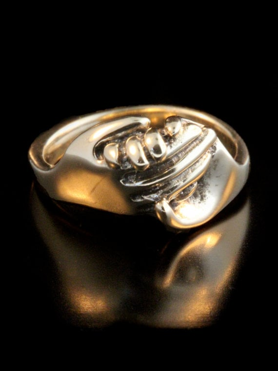 Gold Hand Art Ring ($945)