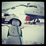 This snowman didn't seem to mind the bad weather at Boston Logan International Airport.  Source: Instagram user ryaneberry