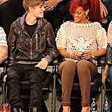 Justin Bieber looked happy to sit next to Rihanna while watching the NBA All-Star Game in February 2011.
