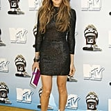 Super hot in a black L'Wren Scott turtleneck dress and white witchy boots at the 2008 MTV Movie Awards.
