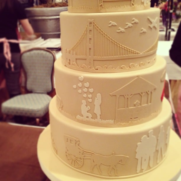 This wedding cake at the San Francisco Wedding Fair tells the love story of the couple.