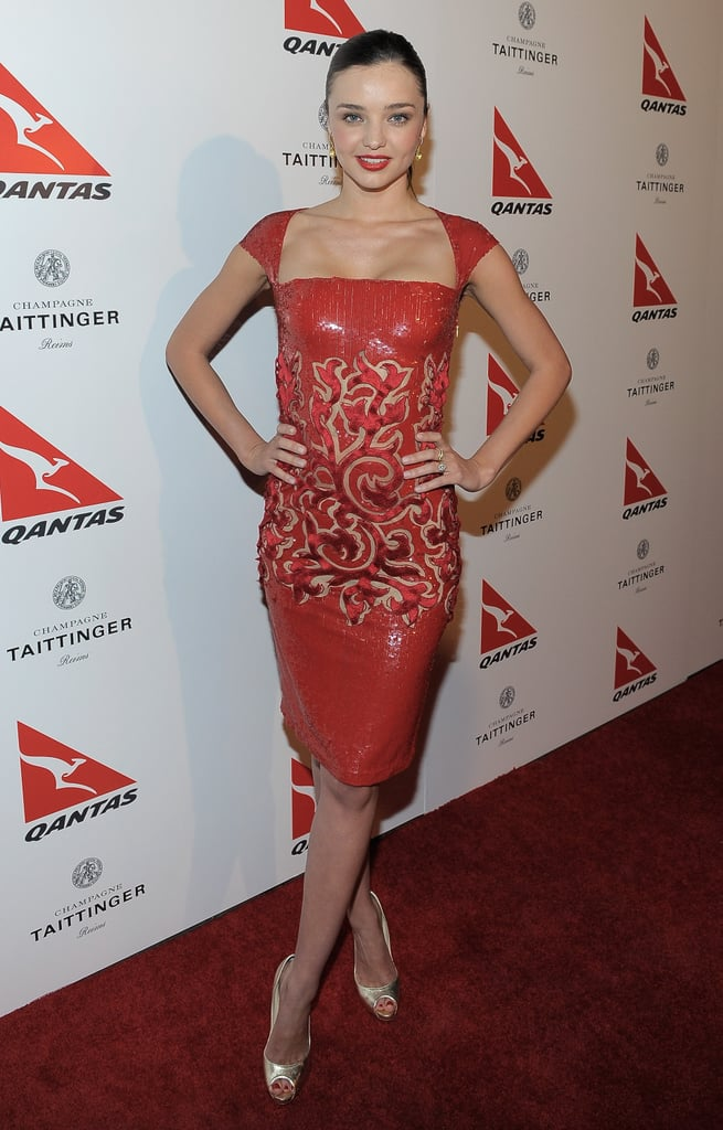 """Miranda Kerr wore a red Georges Chakra dress for the Qantas Airways Spirit of Australia Party on Friday at LA's Roosevelt Hotel. The model is one of the airline's new celebrity ambassadors, along with fellow Aussie David Whitehill. Miranda seems super excited about her latest job. She tweeted yesterday, """"I'm excited to represent Qantas as a global Ambassador. I love everything Australian, and Qantas is an iconic Australian company."""" She was joined by many other Aussie celebs, including Chris Hemsworth, Olivia Newton-John, Teresa Palmer and Ryan Kwanten, as well as John Travolta."""