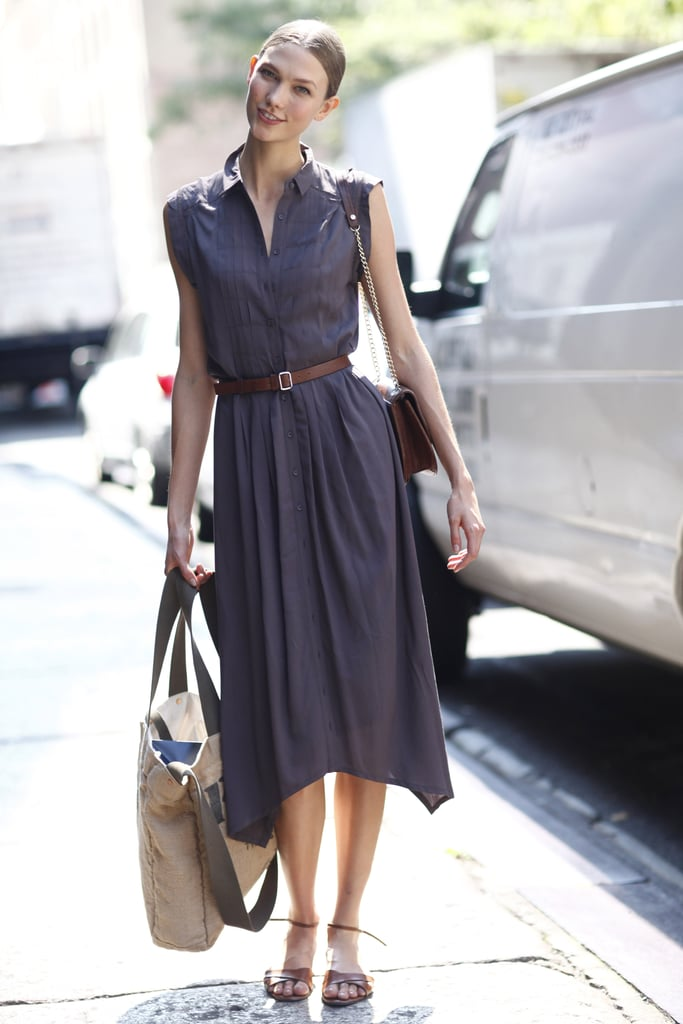 Karlie Kloss looked breezy between shows in a sundress and flat sandals. Source: Greg Kessler