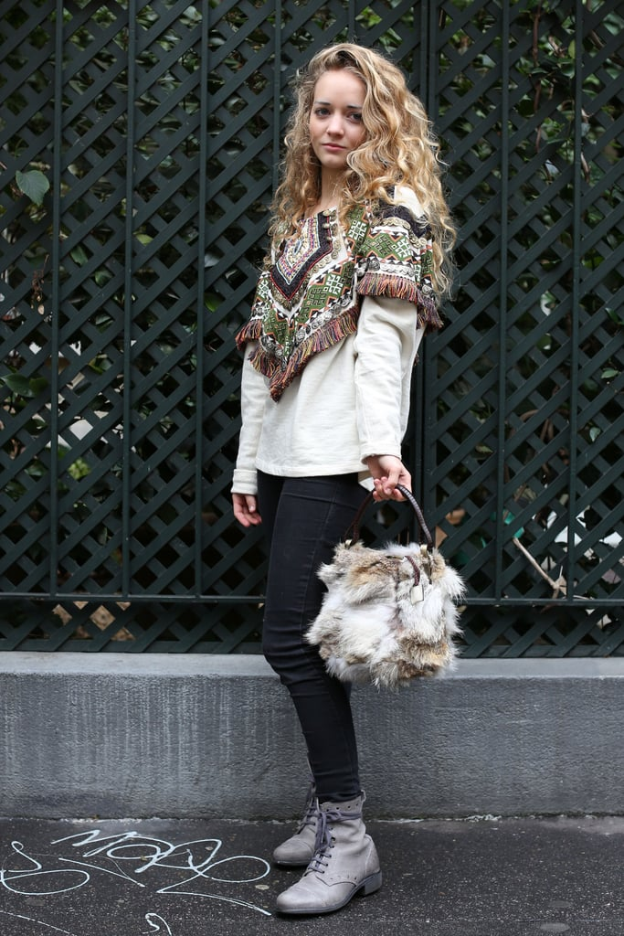 This one is all about the accessories — a fringed capelet and a fur satchel lend quirky luxe.