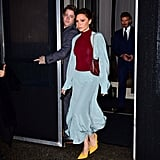 In February 2018, Victoria wore yellow pumps with a sky blue skirt and matching top over a burgundy crewneck sweater.
