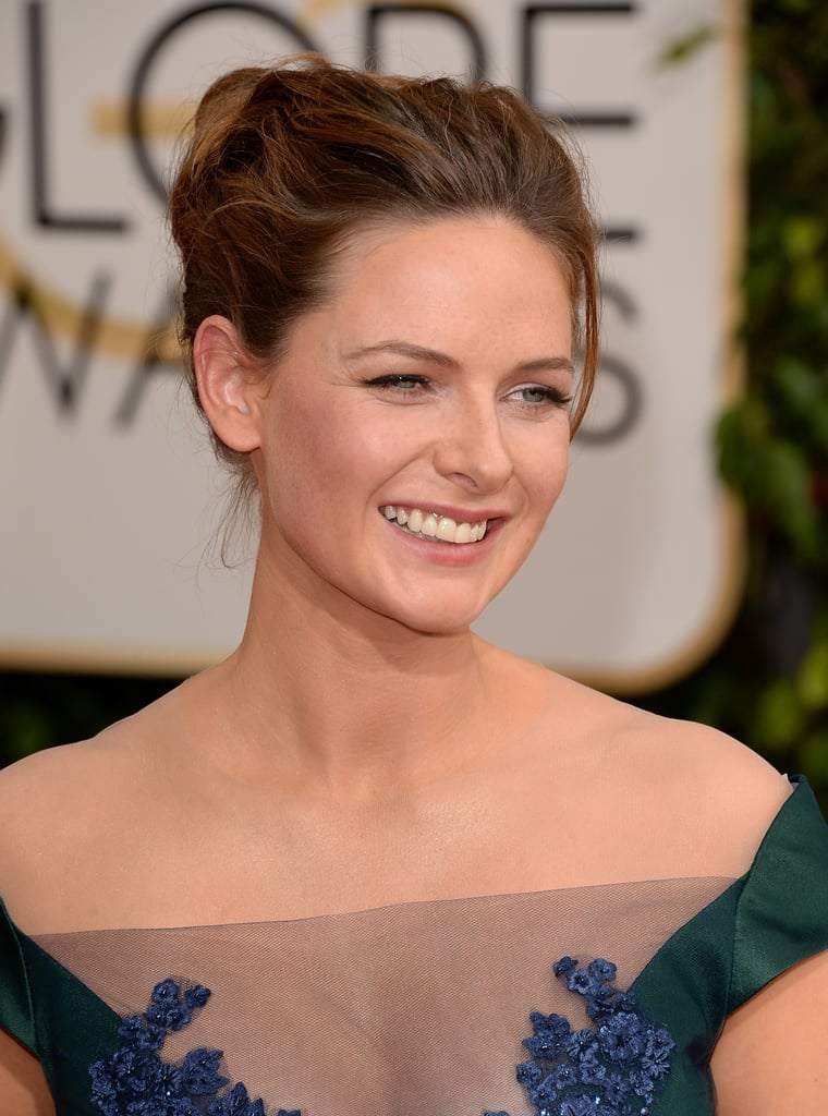 One loose tendril kept Rebecca Ferguson's updo from seeming too prim.