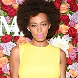 Solange Knowles is known for her love of bright colors, and she didn't disappoint, wearing a neon pink lip hue with her signature bold brows and afro at a Max Mara event.