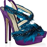 We can't get enough of the pretty color contrast and decadent feathers.  Jimmy Choo Marlene Feather and Suede Sandals ($1,995)