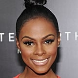 To get a simply sleek knot similar to Tika Sumpter's, pull hair into a tight high ponytail, then twist hair and pin.