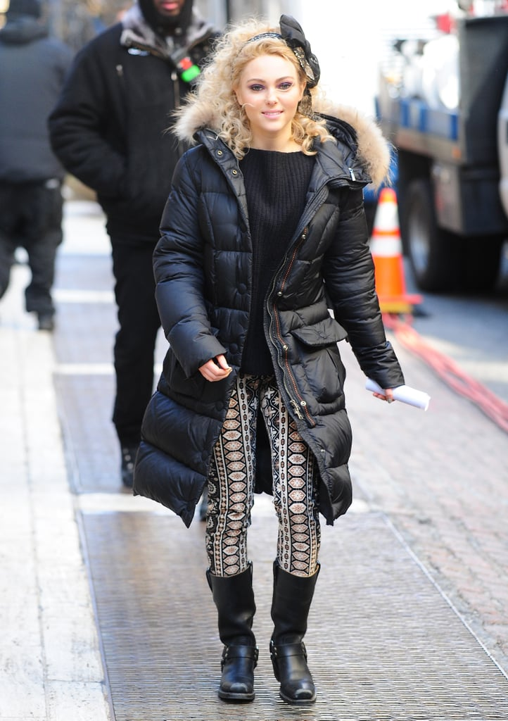 Carrie bundled up in an all-black ensemble — ribbed sweater, puffer coat, and moto boots — and aztec-print pants. Pump up your Winter basics with these cool-girl Topshop leggings ($80).