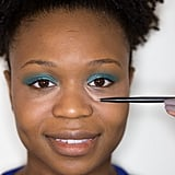 """Once you've blended in your first base of concealer, you might have to go back with more. Makeup artist Kathy Jeung uses this layering technique to draw right over any remaining darkness. This is an especially good tip for blue veins. """"If you have blue under your eyes, anything with peach or pink to it neutralizes the blue rather than covering,"""" she said. """"Draw right where you see the darkness.""""   Use a fluffy brush to dust a yellow loose powder under your eyes like Ben Nye Banana Powder ($30). The shade brightens the entire area and sets the cream for a long-lasting finish.   Highlighting your cheekbones also goes a long way to detract from puffy under-eye circles. You can use anything from lip gloss to eye shadow to create a hint of shimmer in a C shape from brow to cheekbone."""