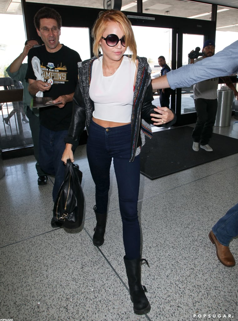 Miley Cyrus's engagement ring was on display as she got onto a plane at LAX.