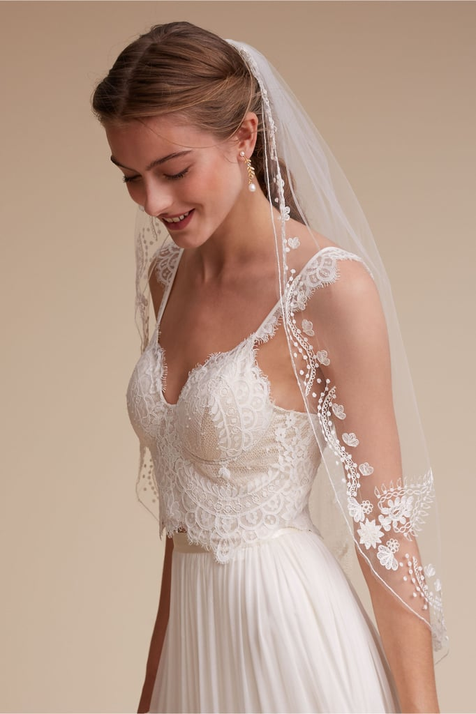 Belgian-inspired embroidery dots this BHLDN veil ($498) for a romantic feel.