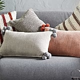 Aldi Herringbone Cushion with Pom Pom