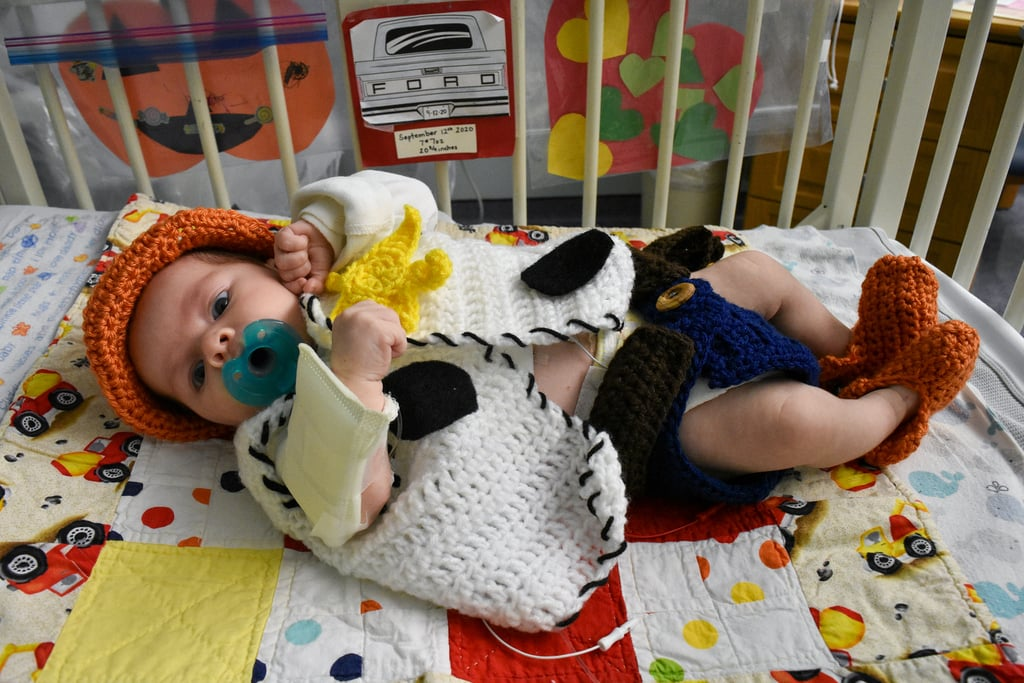 """Having a child in the NICU can understandably be emotionally draining. In an effort to lift families' moods, the nurses at Tallahassee Memorial HealthCare in Florida dressed their tiny patients up in sweet Halloween costumes. After brainstorming some ideas together, staff members got to work making each ensemble, and it's safe to say their hard work paid off. """"We work to make the environment as comfortable as possible for our babies and families,"""" a spokesperson for Tallahassee Memorial HealthCare told POPSUGAR. """"Having a baby in the NICU can be very stressful for new moms and families, especially in the midst of the COVID-19 pandemic. Bringing the Halloween fun to these little ones and their parents is just one of the many ways our team works to normalize the NICU environment and keep families' spirits high. Our crafty NICU night team created the costumes and our day team helped bring their visions to life."""" Get a look at these adorable little cuties all dressed up ahead!      Related:                                                                                                           People Are Sharing Unflattering Photos of Their Pets on Social Media, and How Delightful!"""
