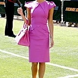 Wearing a hot-pink Roland Mouret dress and matching Birkin bag at David Beckham's Galaxy conference in July 2007.