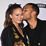 John gave Chrissy a sweet kiss on the cheek at a Sports Illustrated event in February 2017.