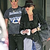 Justin Theroux followed closely behind Jennifer Aniston leaving their NYC apartment.