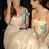Crash costars Sandra Bullock and Thandi Newton were all smiles while chatting and holding onto their brand-new statues during the 2006 SAG Awards in LA.