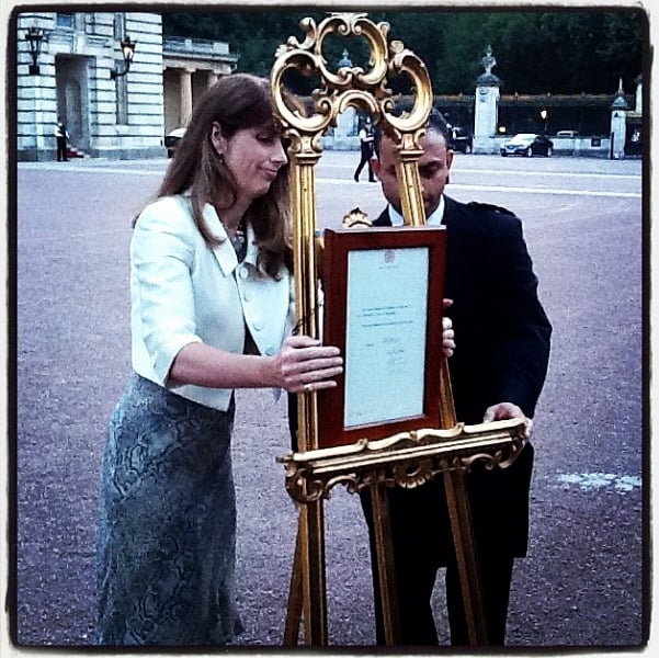 The queen's press secretary and a footman put the official announcement on the easel outside Buckingham Palace. Source: Instagram user the_british_monarchy