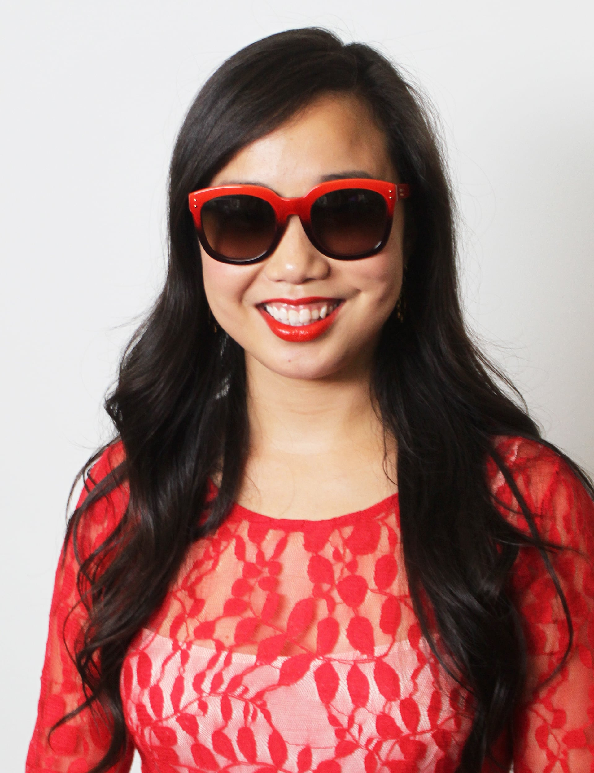 Love brightly colored sunglasses but afraid to go all the way? Try a vivid hue on just the upper rim like on this red-and-black pair from Coach (similar styles: Coach sunglasses). To play off the colored frames, we paired the look with a matching lipstick: Tom Ford's Wild Ginger ($49).