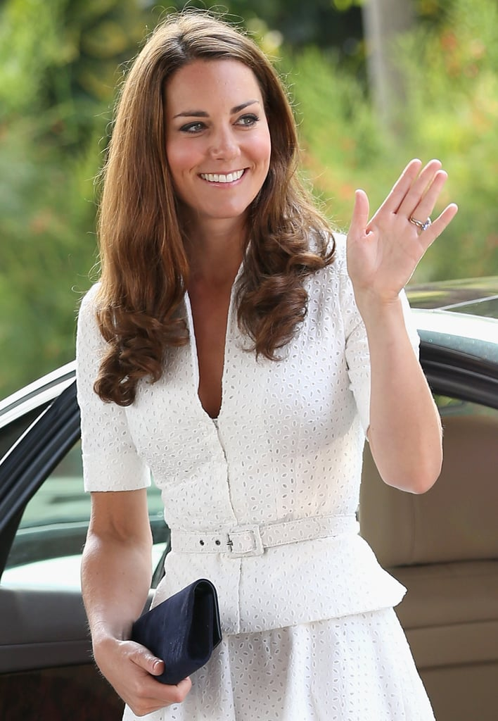 Kate Middleton sported a white belted dress in Singapore.