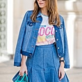 A Buttoned Denim Jacket With a Flared Skirt