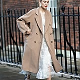 Channel your inner ballerina by styling your flats with an equally girly midi dress and longline coat this season.